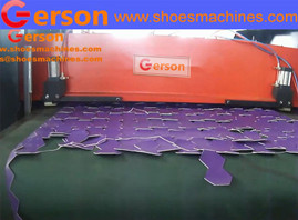 Automatic machine cutting material on conveyor belt